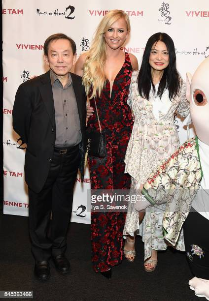 Producer William Kong Danielle Moinet and designer Vivienne Tam pose backstage for Vivienne Tam fashion show during New York Fashion Week The Shows...