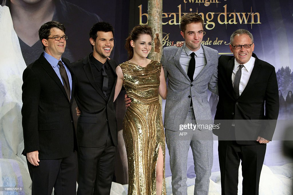 Producer Wyck Godfrey, US actor Taylor Lautner, US actress Kristen Stewart, British actor Robert Pattinson and Director Bill Condon pose prior to the German premier of 'The Twilight Saga: Breaking Dawn - Part 2' film premier in Berlin on November 16, 2012.