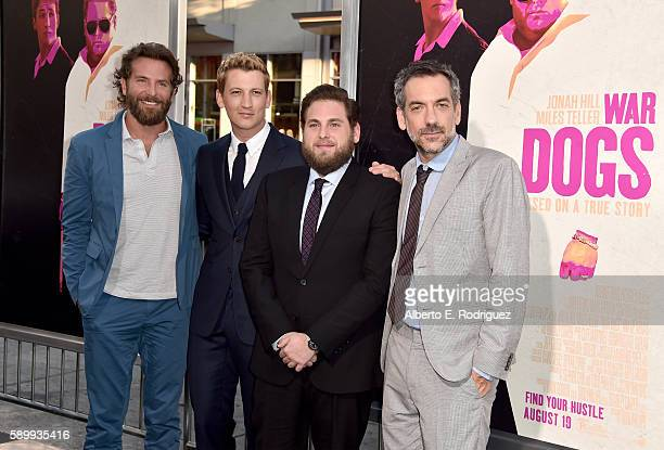 Producer/actor Bradley Cooper actors Miles Teller Jonah Hill and director/writer/producer Todd Phillips attend the premiere of Warner Bros Pictures'...