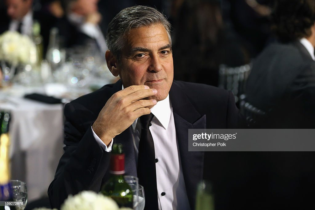 Producer/Actor <a gi-track='captionPersonalityLinkClicked' href=/galleries/search?phrase=George+Clooney&family=editorial&specificpeople=202529 ng-click='$event.stopPropagation()'>George Clooney</a> attends the 18th Annual Critics' Choice Movie Awards held at Barker Hangar on January 10, 2013 in Santa Monica, California.