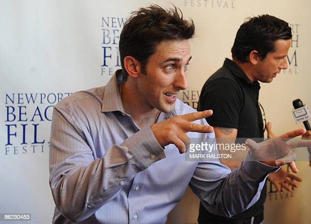 Producer/Actor Paul Alessi gestures beside actor Ross McCall as they arrive for the premiere of the film 'Knuckle Draggers' at the Newport Beach Film...