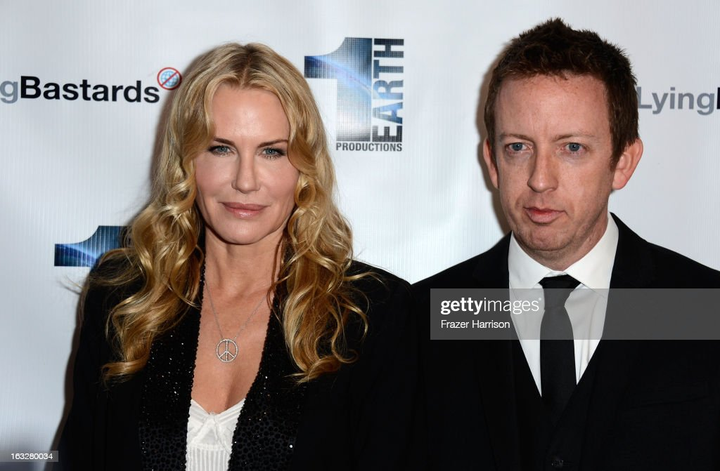Producer/actress <a gi-track='captionPersonalityLinkClicked' href=/galleries/search?phrase=Daryl+Hannah&family=editorial&specificpeople=201860 ng-click='$event.stopPropagation()'>Daryl Hannah</a> and director Craig Scott Rosebraugh arrives at the screening of 'Greedy Lying Bastards' at Harmony Gold Theatre on March 6, 2013 in Los Angeles, California.
