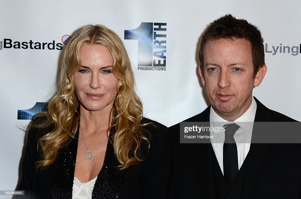 Producer/actress Daryl Hannah and director Craig Scott Rosebraugh arrives at the screening of 'Greedy Lying Bastards' at Harmony Gold Theatre on March 6, 2013 in Los Angeles, California.