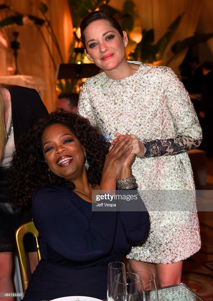Producer/actress Oprah Winfrey (L) and actress Marion Cotillard attend The Weinstein Company's Academy Awards Nominees Dinner in partnership with Chopard, DeLeon Tequila, FIJI Water and MAC Cosmetics on February 21, 2015 in Los Angeles, California.