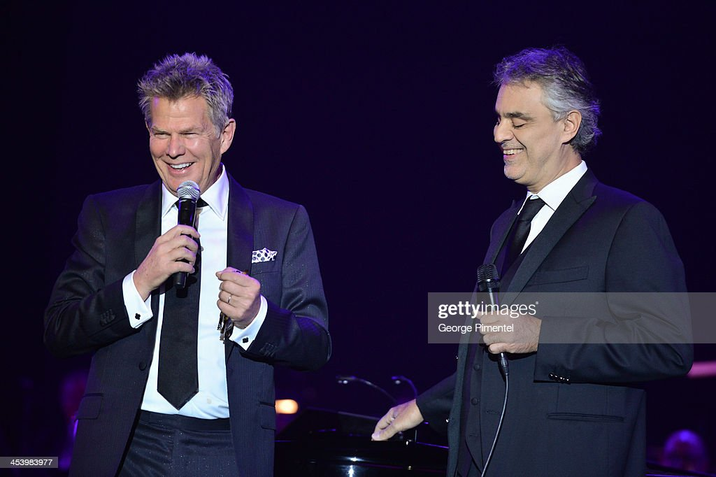Producer/composer <a gi-track='captionPersonalityLinkClicked' href=/galleries/search?phrase=David+Foster&family=editorial&specificpeople=210611 ng-click='$event.stopPropagation()'>David Foster</a> and opera singer <a gi-track='captionPersonalityLinkClicked' href=/galleries/search?phrase=Andrea+Bocelli&family=editorial&specificpeople=211558 ng-click='$event.stopPropagation()'>Andrea Bocelli</a> speak at the <a gi-track='captionPersonalityLinkClicked' href=/galleries/search?phrase=David+Foster&family=editorial&specificpeople=210611 ng-click='$event.stopPropagation()'>David Foster</a> Foundation Benefit Concert at Allstream Centre on December 5, 2013 in Toronto, Canada.