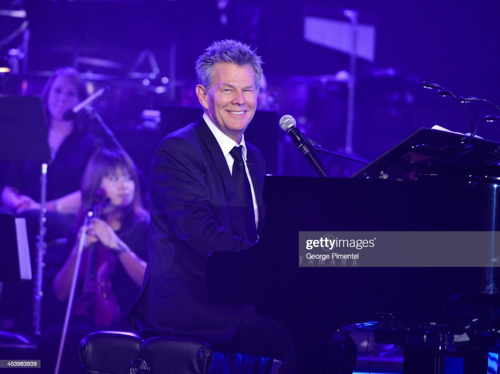 Producer/composer <a gi-track='captionPersonalityLinkClicked' href=/galleries/search?phrase=David+Foster&family=editorial&specificpeople=210611 ng-click='$event.stopPropagation()'>David Foster</a> performs at the <a gi-track='captionPersonalityLinkClicked' href=/galleries/search?phrase=David+Foster&family=editorial&specificpeople=210611 ng-click='$event.stopPropagation()'>David Foster</a> Foundation Benefit Concert at Allstream Centre on December 5, 2013 in Toronto, Canada.
