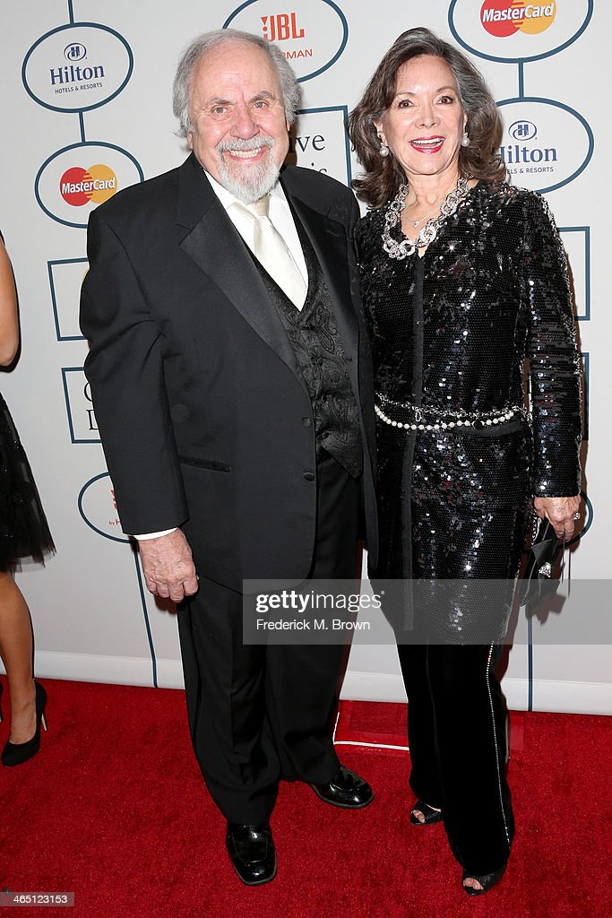 Producer/director George Schlatter (L) and actress Jolene Brand attend the 56th annual GRAMMY Awards Pre-GRAMMY Gala and Salute to Industry Icons honoring Lucian Grainge at The Beverly Hilton on January 25, 2014 in Beverly Hills, California.
