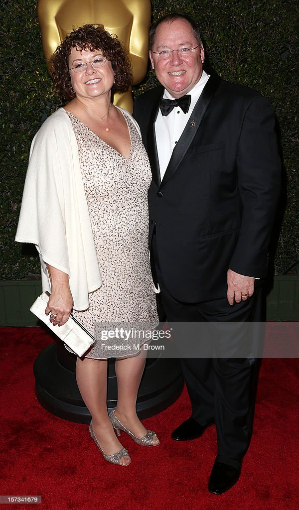 Producer/director <a gi-track='captionPersonalityLinkClicked' href=/galleries/search?phrase=John+Lasseter&family=editorial&specificpeople=224003 ng-click='$event.stopPropagation()'>John Lasseter</a> (R) and his wife attend the Academy Of Motion Picture Arts And Sciences' 4th Annual Governors Awards at Hollywood and Highland on December 1, 2012 in Hollywood, California.