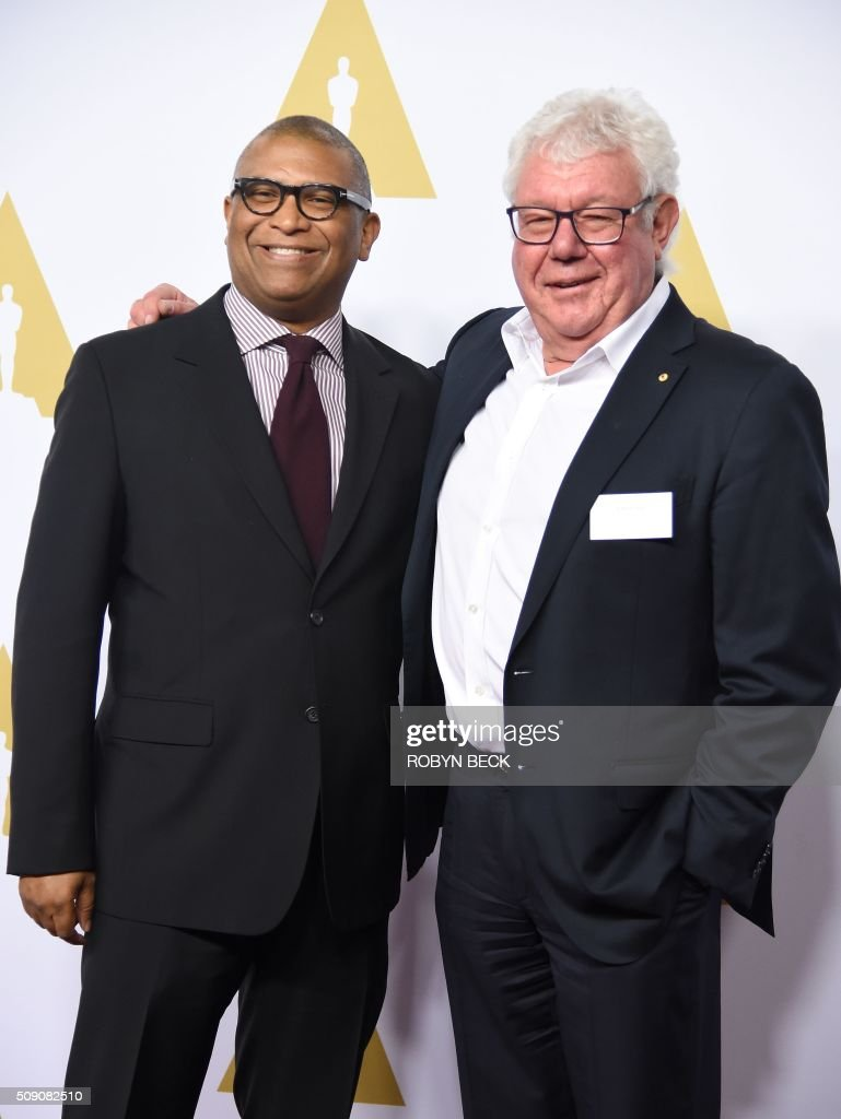 Producer/director Reginald Hudlin (L) and producer David Hill arrive at the 88th Oscar Nominees Luncheon in Beverly Hills, California, February 8, 2016 / AFP / ROBYN BECK
