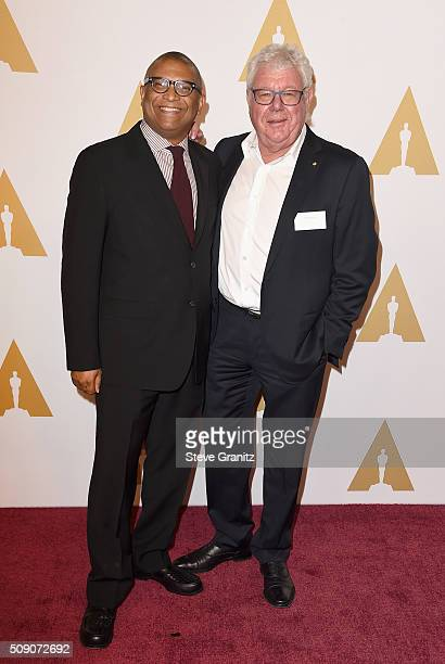 Producer/director Reginald Hudlin and producer David Hill attend the 88th Annual Academy Awards nominee luncheon on February 8 2016 in Beverly Hills...