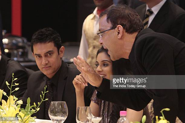 Producerdirector Vidhu Vinod Chopra in an animated conversation with actors Asin Thottumkal and Aamir Khan at the Gala Diner of the India Today...