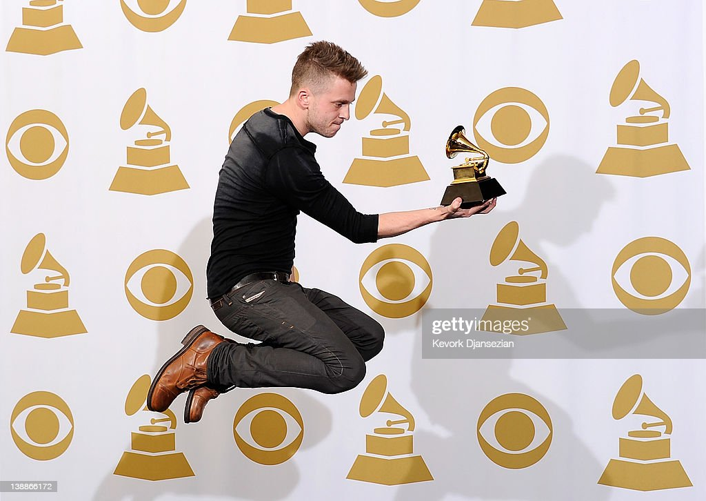 Producer/engineer <a gi-track='captionPersonalityLinkClicked' href=/galleries/search?phrase=Ryan+Tedder&family=editorial&specificpeople=4651553 ng-click='$event.stopPropagation()'>Ryan Tedder</a>, winner of the GRAMMY for Album of the Year for '21', poses in the press room at the 54th Annual GRAMMY Awards at Staples Center on February 12, 2012 in Los Angeles, California.