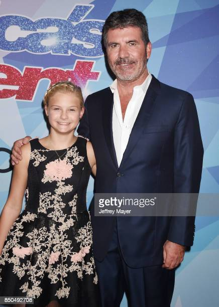 Producerentrepreneurphilanthropist Simon Cowell and ventriloquistsinger Darci Lynne Farmer attend NBC's 'America's Got Talent' Season 12 Finale at...