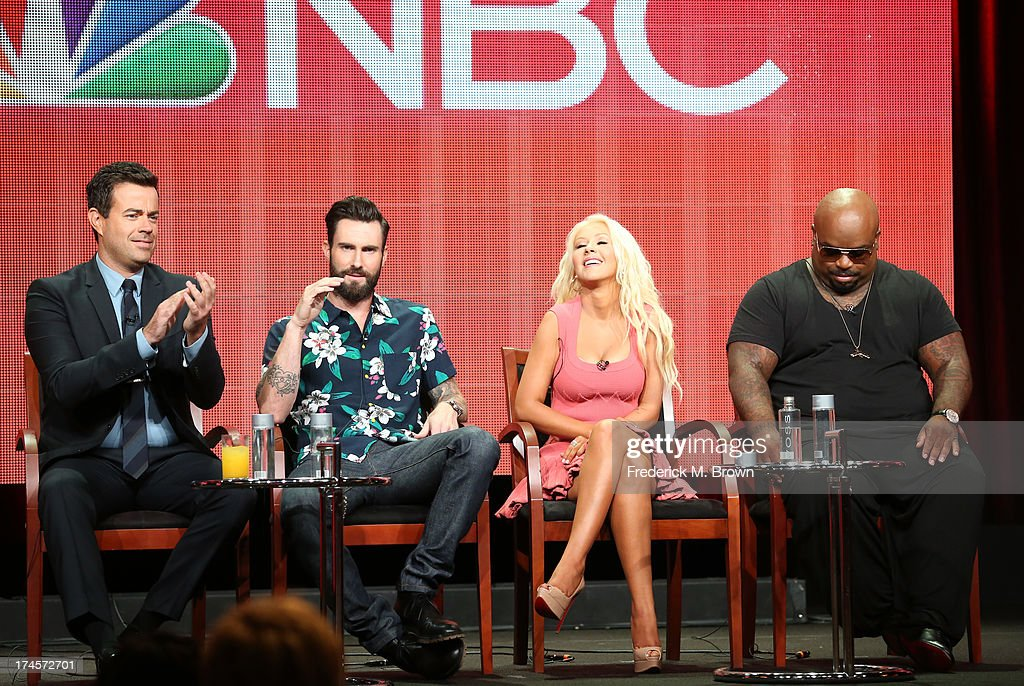 Producer/Host Carson Daly and coaches Adam Levine, Christina Aguilera, and CeeLo Green speak onstage during 'The Voice' panel discussion at the NBC portion of the 2013 Summer Television Critics Association tour - Day 4 at the Beverly Hilton Hotel on July 27, 2013 in Beverly Hills, California.