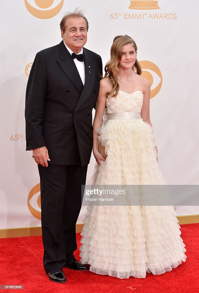 Producer/manager Larry Thompson (L) and Taylor Thompson arrive at the 65th Annual Primetime Emmy Awards held at Nokia Theatre L.A. Live on September 22, 2013 in Los Angeles, California.