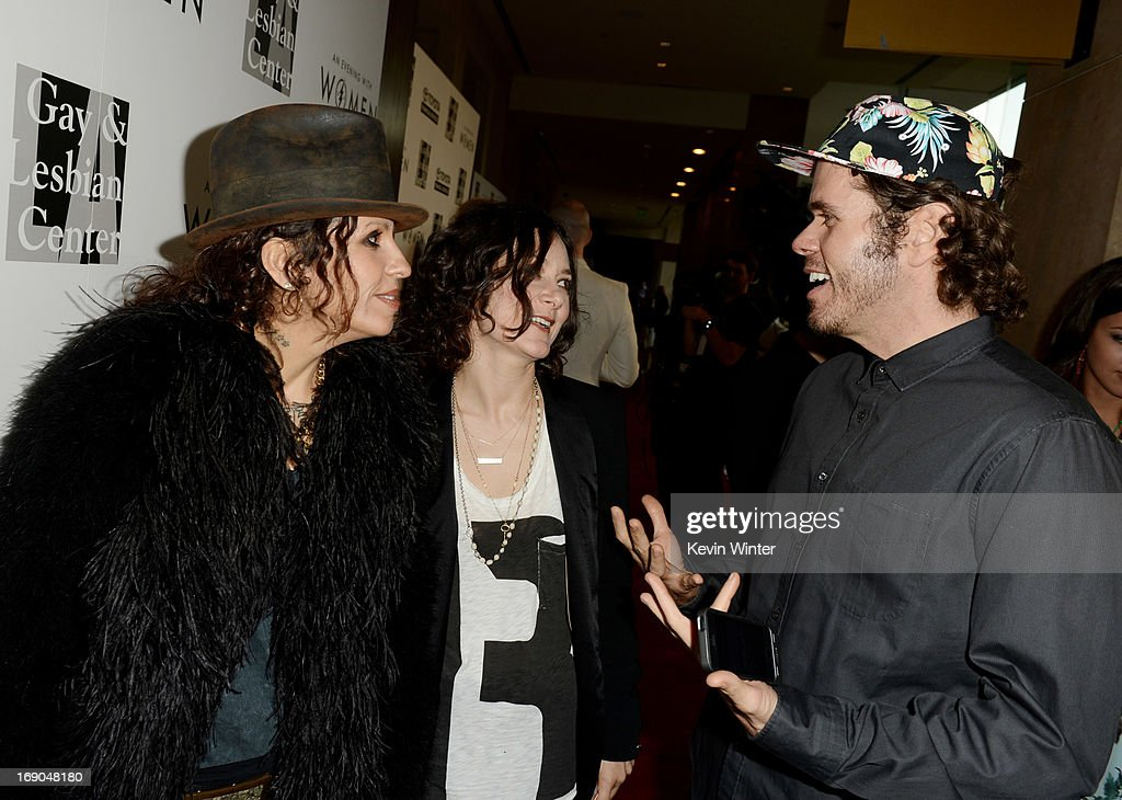 Producer/musician Linda Perry,her partner actress Sara Gilbert and blogger Perez Hilton arrive at An Evening With Women benefiting The L.A. Gay & Lesbian Center at the Beverly Hilton Hotel on May 18, 2013 in Beverly Hills, California.