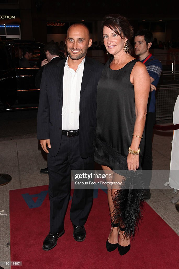 Producers Amir Bar-Lev and Meghan O'Hara (R) attend the '12.12.12.' premiere during the 2013 Toronto International Film Festival at Winter Garden Theatre on September 8, 2013 in Toronto, Canada.