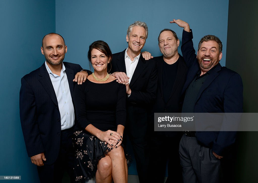 Producers Amir BarLev Meghan O'Hara John Sykes Harvey Weinstein and James Dolan of '121212' pose at the Guess Portrait Studio during 2013 Toronto...