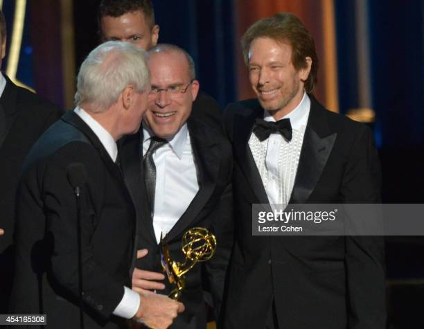 Producers Bertram van Munster and Jerry Bruckheimer speak onstage at the 66th Annual Primetime Emmy Awards held at Nokia Theatre LA Live on August 25...
