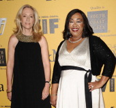 Producers Betsy Beers and Shonda Rhimes attend the Women In Film 2014 Crystal Lucy Awards at the Hyatt Regency Century Plaza on June 11 2014 in...