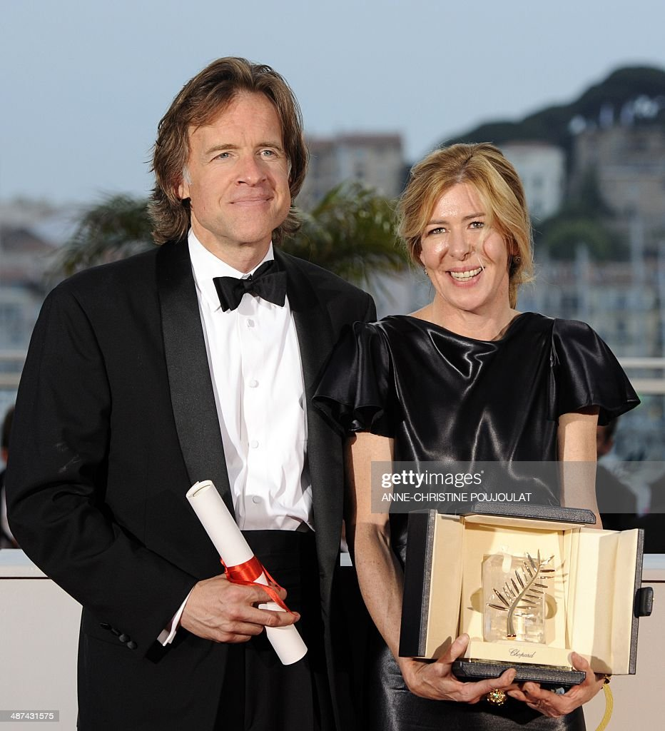 Producers Bill Pohlad and Dede Gardner pose during a photocall after receiving on behalf of US director Terrence Malick the Palme D'Or for the movie...