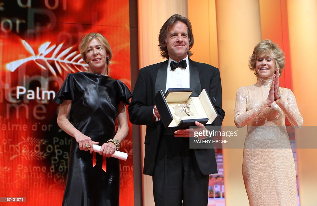 Producers Bill Pohlad and Dede Gardner (L) pose with US actress Jane Fonda as they received on behalf of US director Terrence Malick the Palme D'Or for the movie 'The Tree of Life' during the closing ceremony of the 64th Cannes Film Festival on May 22, 2011 in Cannes.