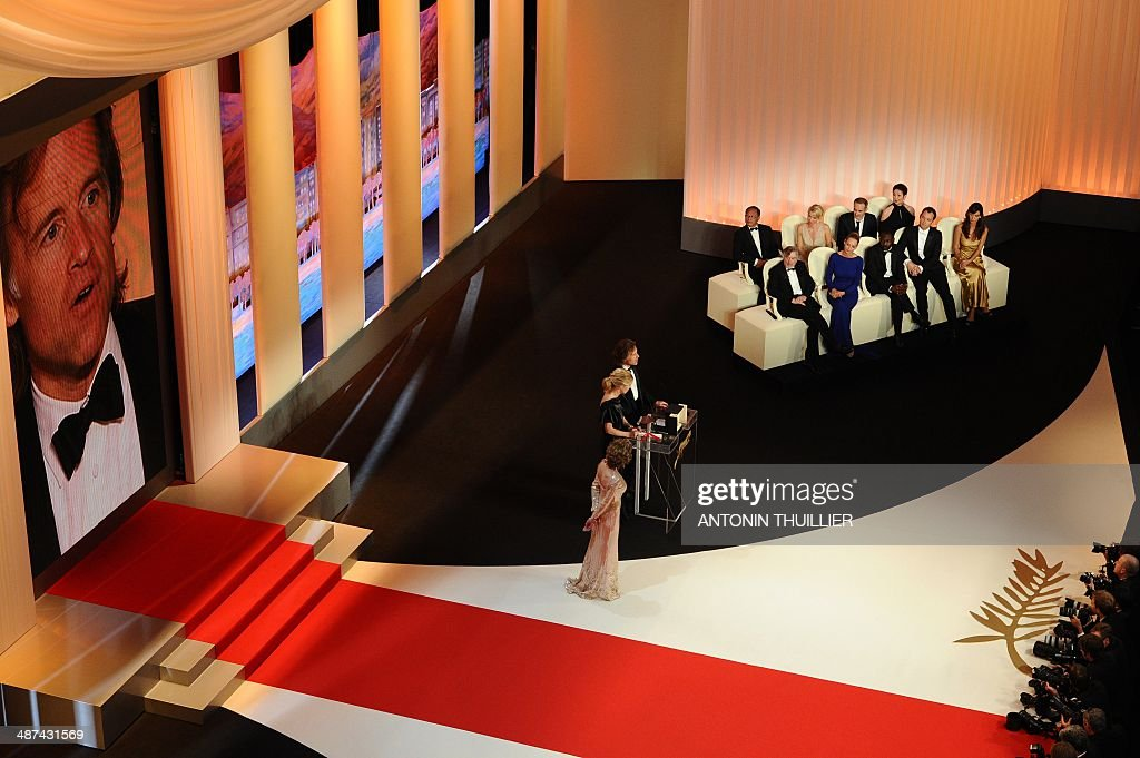 Producers Bill Pohlad and Dede Gardner speak next to US actress Jane Fonda as they received on behalf of US director Terrence Malick the Palme D'Or for the movie 'The Tree of Life' during the closing ceremony of the 64th Cannes Film Festival on May 22, 2011 in Cannes.