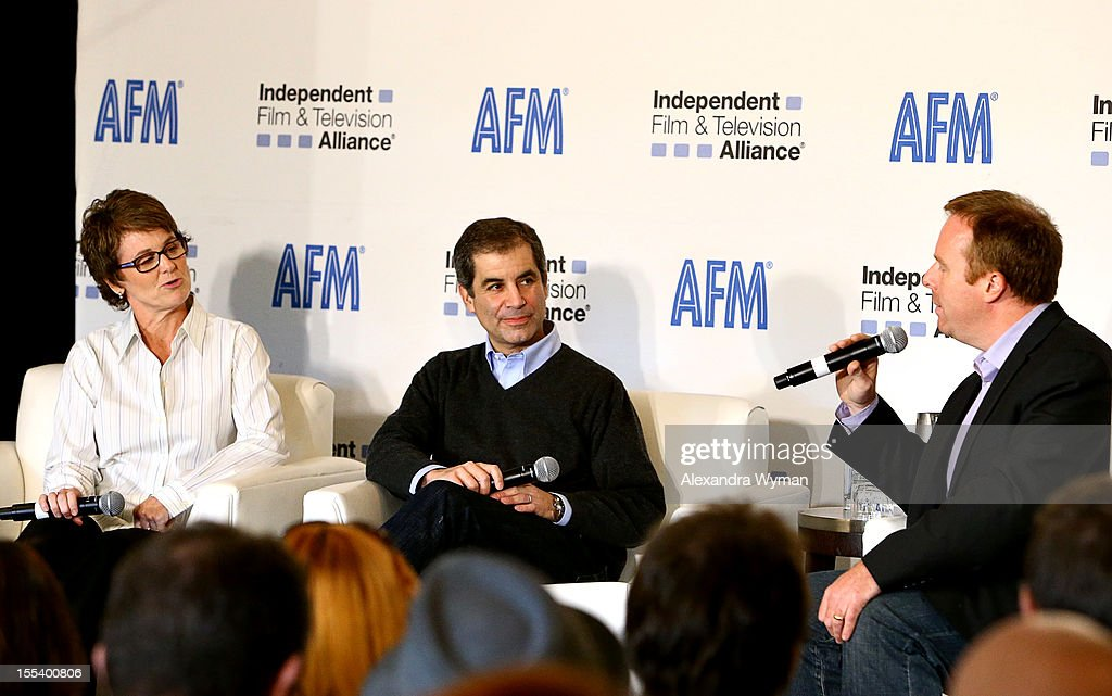 Producers Bonnie Curtis, Victor Levin and Host, Scott Roxborough of The Hollywood Reporter speak at 'A Conversation with Bonnie Curtis and Victor Levin' at the Loews Santa Monica Beach Hotel on November 3, 2012 in Santa Monica, California.