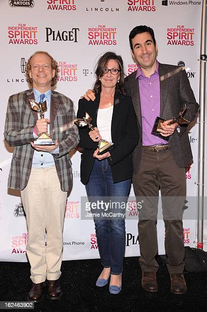 Producers Bruce Cohen Donna Gigliotti and Jonathan Gordon pose with the Best Feature award for Silver Linings Playbook during the 2013 Film...