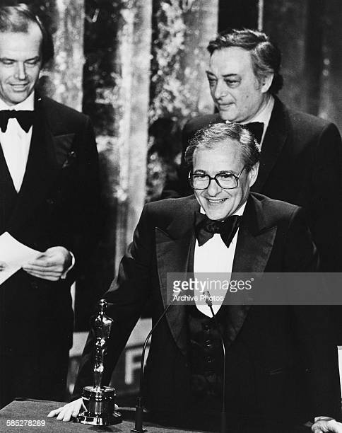 Producers Charles H Joffe and Jack Rollins on stage receiving the Best Picture Oscar for the film 'Annie Hall' from presented Jack Nicholson at the...