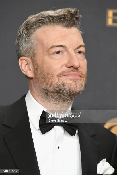 Producers Charlie Brooker winner of the award for Outstanding Television Movie for 'Black Mirror' poses in the press room during the 69th Annual...