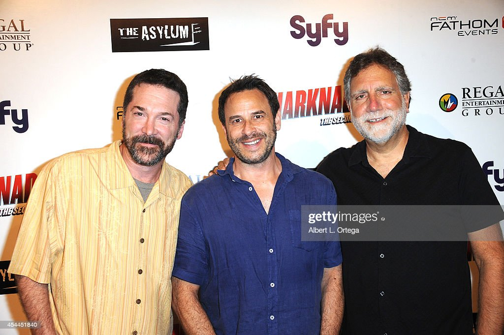 Producers David Rimawi, David Michael Latt and David L. Garber arrive for the Premiere Of The Asylum & Fathom Events' 'Sharknado 2: The Second One' held at Regal Cinemas L.A. Live on August 21, 2014 in Los Angeles, California.