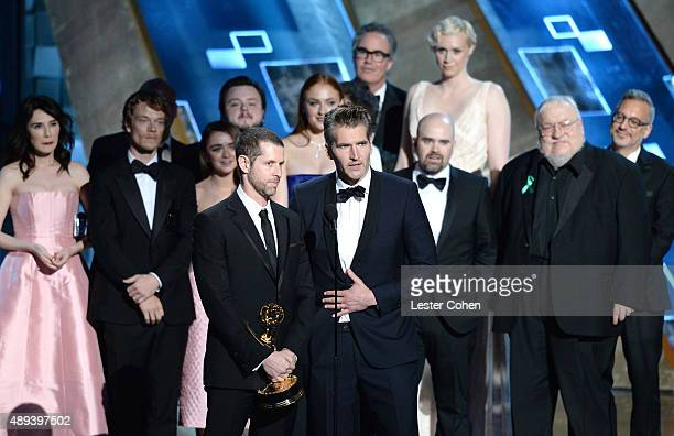 Producers DB Weiss and David Benioff with cast and crew of 'Game of Thrones' accept an award onstage during the 67th Annual Primetime Emmy Awards at...