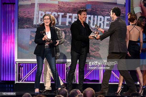 Producers Donna Gigliotti and Jonathan Gordon accept the Best Feature award for 'Silver Linings Playbook' from presenter Dennis Quaid onstage during...