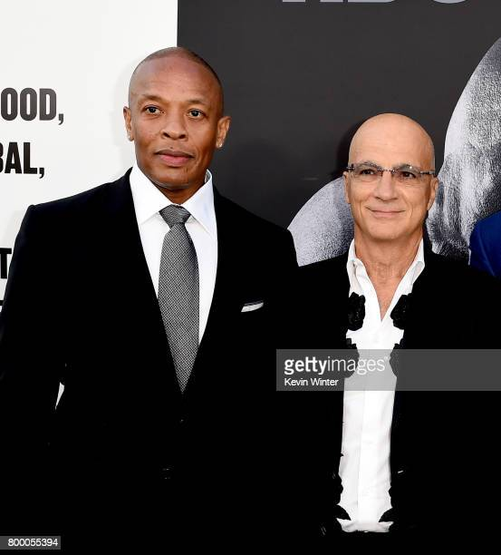 Producers Dr Dre and Jimmy Iovine arrive at the premiere screening of HBO's 'The Defiant Ones' at Paramount Studios on June 22 2017 in Los Angeles...