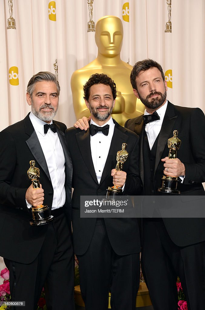 Producers George Clooney and Grant Heslov and actorproducerdirector Ben Affleck winners of the Best Picture award for 'Argo' pose in the press room...