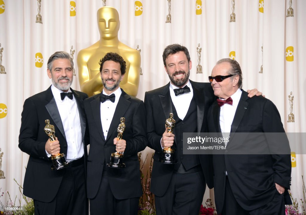 Producers George Clooney and Grant Heslov and actorproducerdirector Ben Affleck winners of the Best Picture award for 'Argo' with presenter Jack...