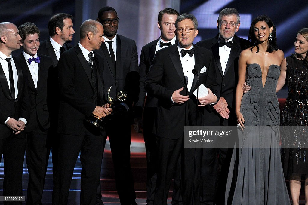 Producers Gideon Raff, Howard Gordon and Alex Gansa, and actress Morena Baccarin accept Outstanding Drama Series award for 'Homeland' onstage during the 64th Annual Primetime Emmy Awards at Nokia Theatre L.A. Live on September 23, 2012 in Los Angeles, California.