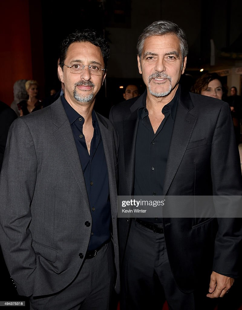 Producers Grant Heslov (L) and George Clooney attend the premiere of Warner Bros. Pictures' 'Our Brand Is Crisis' at TCL Chinese Theatre on October 26, 2015 in Hollywood, California.