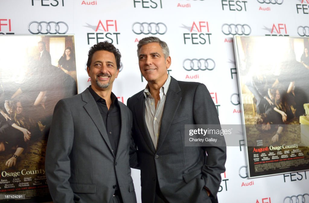 Producers Grant Heslov (L) and George Clooney attend the premiere of The Weinstein Company's 'August: Osage County' during AFI FEST 2013 presented by Audi at TCL Chinese Theatre on November 8, 2013 in Hollywood, California.