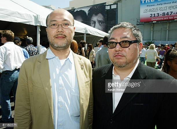 Producers Hidetaka Ikuta and Yoshihiko Shinoda attend the premiere of Warner Bros 'YuGiOh The Movie' at the Chinese Theater August 7 2004 in Los...
