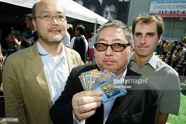 Producers Hidetaka Ikuta Yoshihiko Shinoda and Norman Grossfeld attend the premiere of Warner Bros 'YuGiOh The Movie' at the Chinese Theater August 7...