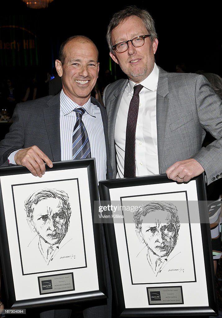 Producers Howard Gordon and Alex Gansa receive the Upton Sinclair Award at Liberty Hill's Upton Sinclair Awards Dinner Honors - Show at The Beverly Hilton Hotel on April 23, 2013 in Beverly Hills, California.