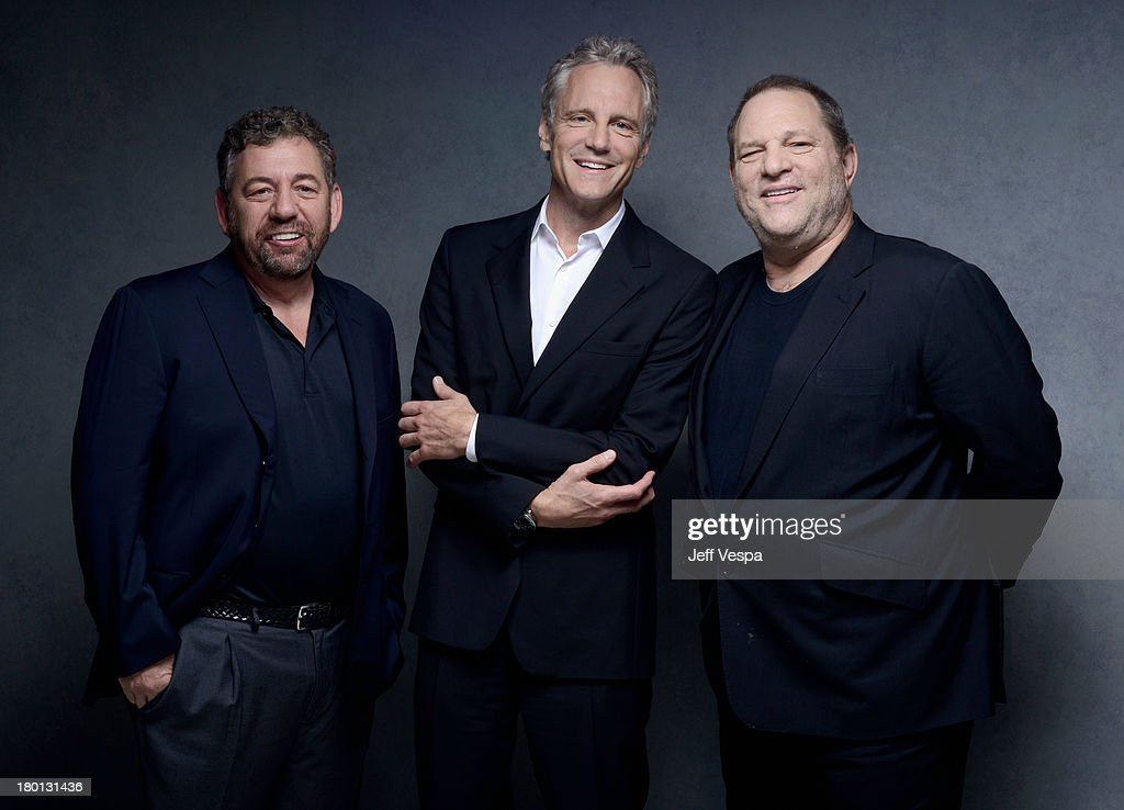 Producers James Dolan John Sykes and Harvey Weinstein of '121212' pose at the Guess Portrait Studio during 2013 Toronto International Film Festival...