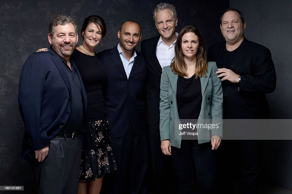 Producers James Dolan Meghan O'Hara Amir BarLev John Sykes Victoria Parker and Harvey Weinstein of '121212' pose at the Guess Portrait Studio during...