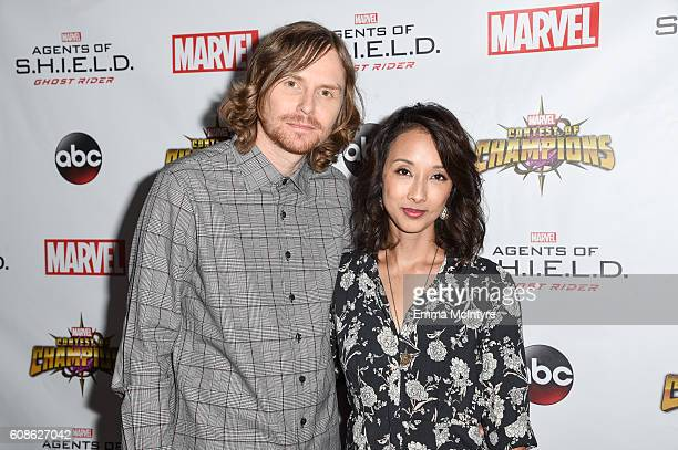 Producers Jed Whedon and Maurissa Tancharoen attends the premiere of ABC's 'Agents of Shield' Season 4 at Pacific Theatre at The Grove on September...