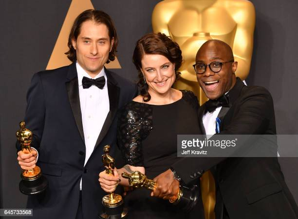 Producers Jeremy Kleiner Adele Romanski and director Barry Jenkins winners of the Best Picture award for 'Moonlight' pose in the press room during...