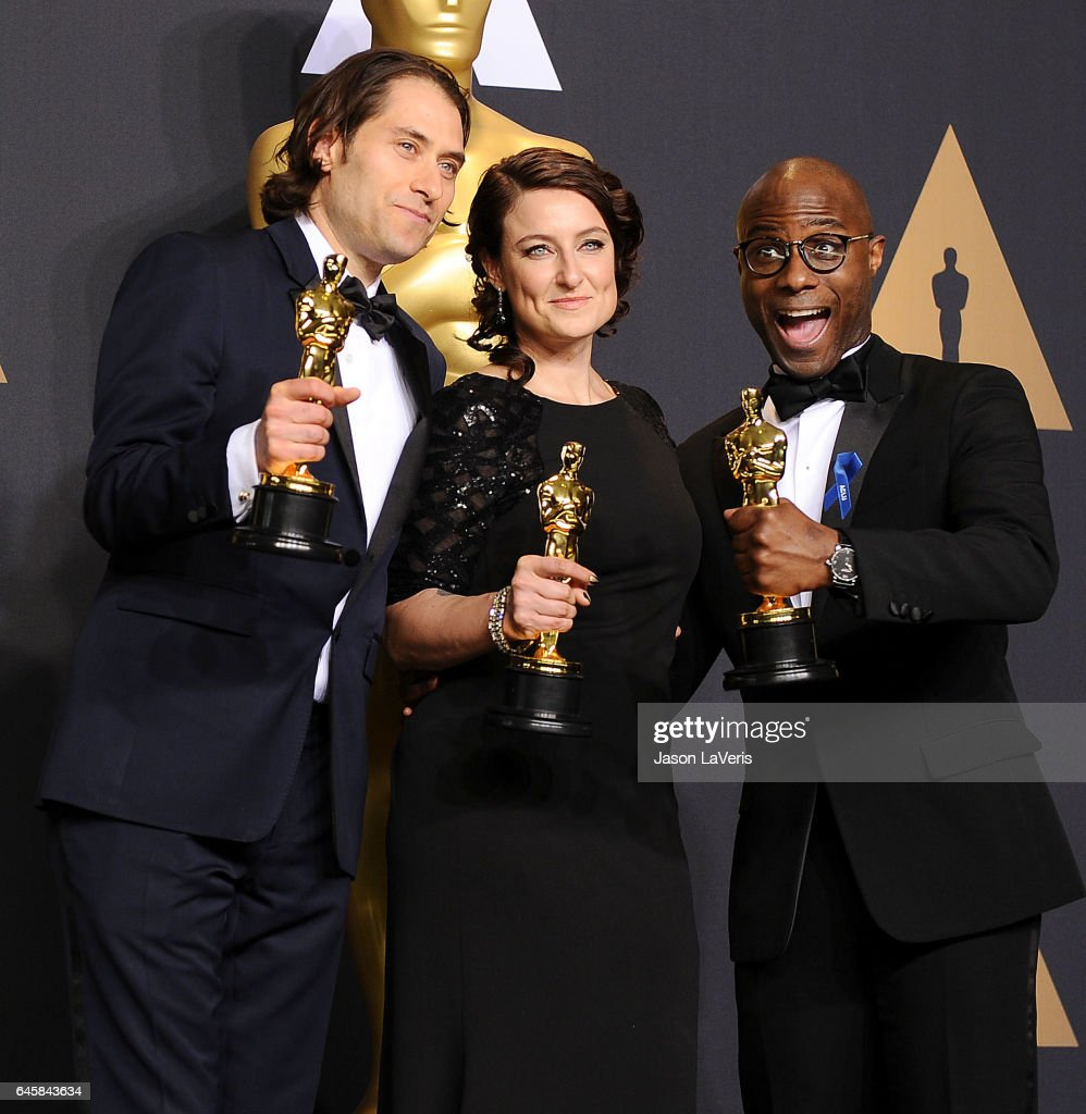 Producers Jeremy Kleiner (L) and Adele Romanski (C), winners of the award for Best Picture for 'Moonlight,' pose with filmmaker Barry Jenkins in the press room at the 89th annual Academy Awards at Hollywood & Highland Center on February 26, 2017 in Hollywood, California.