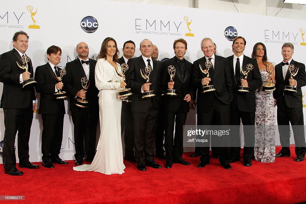 Producers Jerry Bruckheimer and Bertram van Munster pose with the crew of the Amazing Race in the press room during the 64th Primetime Emmy Awards at Nokia Theatre L.A. Live on September 23, 2012 in Los Angeles, California.