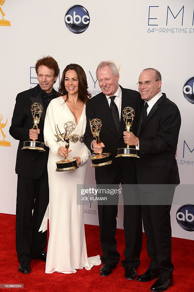 Producers Jerry Bruckheimer, Elise Doganieri, Bertram van Munster and Jonathan Littman, winners Outstanding Reality-Competition for 'The Amazing Race,' pose in the press room during the 64th Annual Primetime Emmy Awards on September 23, 2012 in Los Angeles. AFP PHOTO / JOE KLAMAR